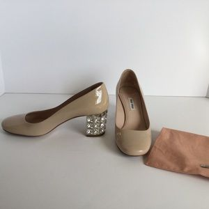 Miu Miu Crystal Heeled Patent Pumps in Nude